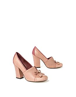 Anthropologie com Veery Heeled Loafers from anthropologie.com