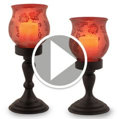 Watch	The Flameless Hurricane Pillar Candles in action
