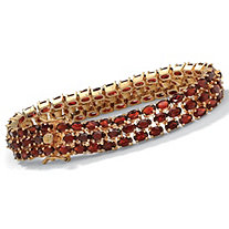 27.50 TCW Oval Cut Genuine Garnet 14k Yellow Gold-Plated Triple-Row Tennis Bracelet 8 1/2""
