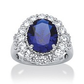 7.39 TCW Oval Midnight Blue Sapphire and Round Cubic Zirconia Ring in Platinum Over Sterling Silver