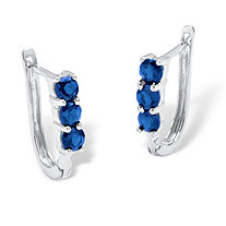 1.20 TCW Oval Sapphire Elongated Hoop Earrings in Platinum over Sterling Silver.