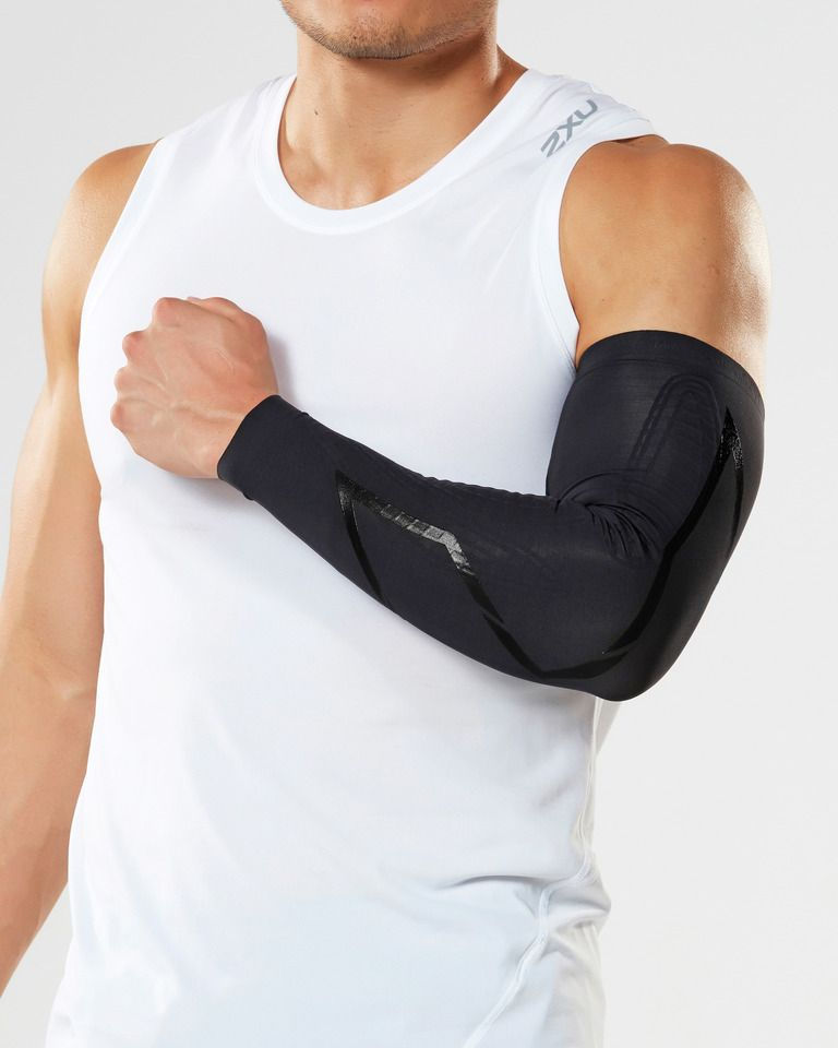 2XU® Elite MCS Compression Arm Guards :: Power up your arms. Introducing the Elite MCS Arm Guards with a revolutionary fabric support system traced over key arm muscle, tendon and fascia groups for unparallel power and support. Engineered with powerful PWX FLEX (70D) these are the ultimate arm guards for any sports and activities with dynamic, intense or repetitive arm movements - basketball, baseball, tennis, golf, weight lifting to rowing. Graduated compression also offers improved warm up pre exercise and faster recovery post exercise. Anatomical left and right arm guard for precise targeted support.   This web exclusive item ships separately within the continental U.S. only. You can count on this item to ship in 3-5 business days!