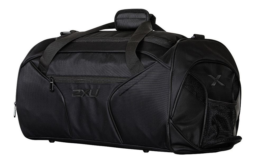 2XU® Gym Bag :: Engineered to meet all gym demands, this 2XU® Gym Bag features an adjustable strap with shoulder padding to ensure comfort and versatility. With protective studs on the bottom, this Bag is the ultimate workout companion to store all essentials. Complete with multiple zipped pockets, water bottle holder and inner shoe compartment, this Bag offers secure and accessible storage.   This web exclusive item ships separately within the continental U.S. only. You can count on this item to ship in 3-5 business days!