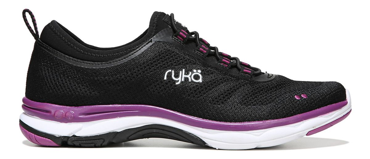 This is a pair of pre-owned Ryka Teanna shoes in great condition. They were only worn a couple of times. They are primarily white canvas with mesh sides .