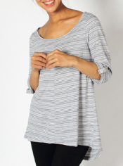 The Go-To Stripe Tunic, crafted from drirelease® performance fabric, is quick...